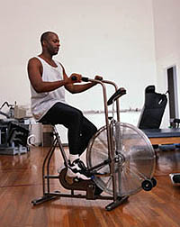 Picture of a man exercising on a stationary bicycle