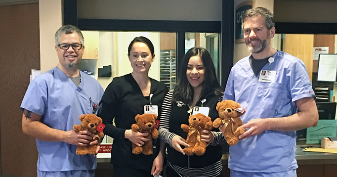 Barton Health ED staff with teddy bears.