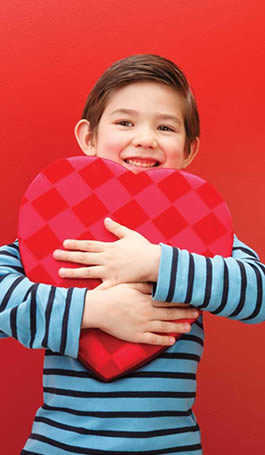 Photo of boy holding a heart