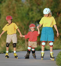 Picture of a family, wearing helmets, rollerblading