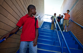Boy threatened on the stairs at school