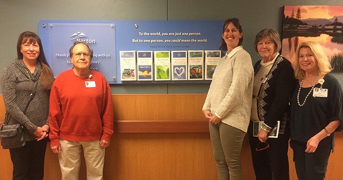 Patient Family Advisory Council stands in front of new care kiosk at Barton Hospital.