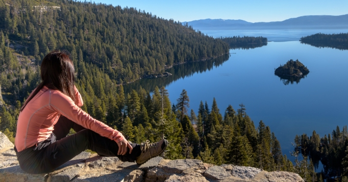 Woman looking over Emerald Bay, Lake Tahoe.