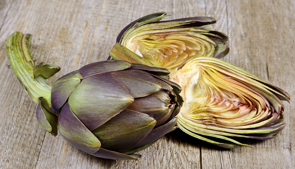 Artichokes on a cutting board.