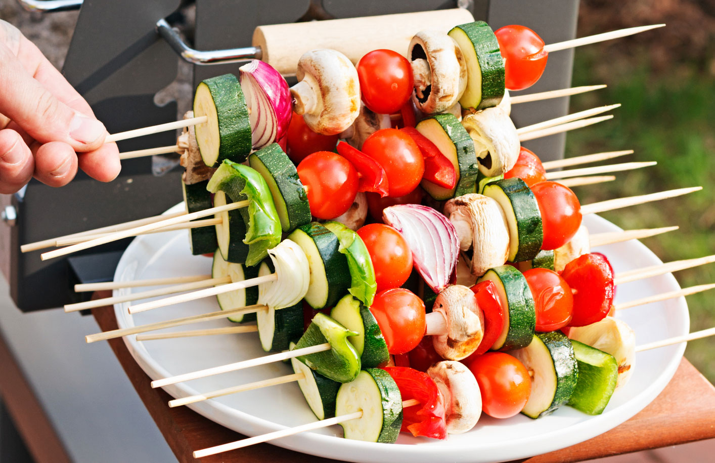 Grilled veggie kebabs on a plate.