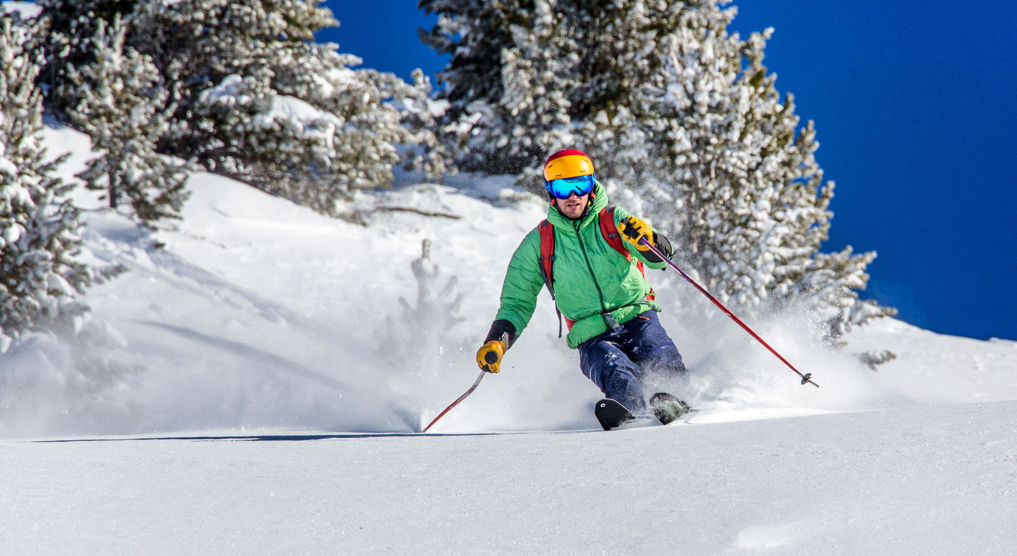 Skier in powdery snow.