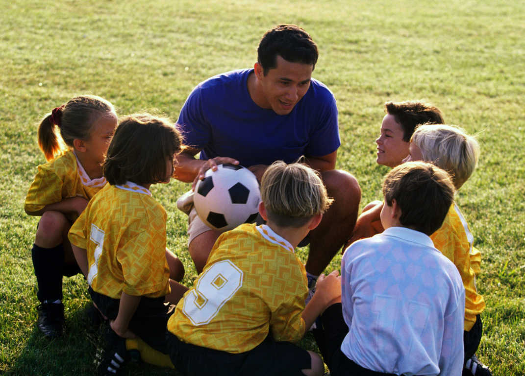 Soccer coach with his team.